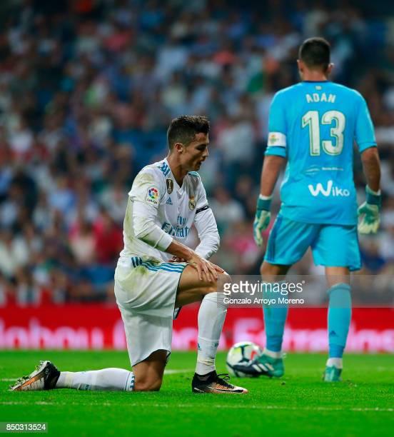 Cristiano Ronaldo of Real Madrid CF reacts behind goalkeeper Antonio Adan of Real Betis Balompie during the La Liga match between Real Madrid CF and...