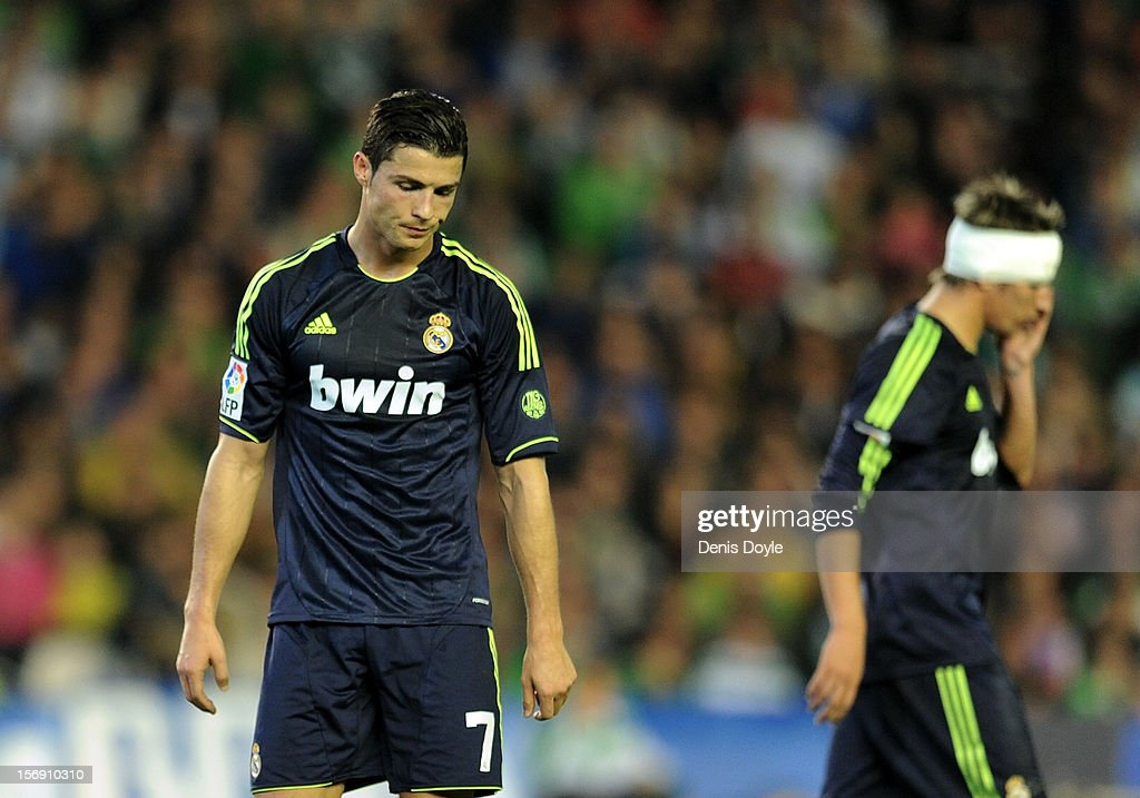 Cristiano Ronaldo (L) of Real Madrid CF reacts beside Fabio Coentrao during the La Liga match between Real Betis Balompie and Real Madrid CF at Estadio Benito Villamarin on November 24, 2012 in Seville, Spain.
