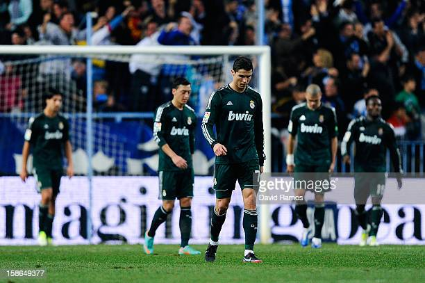 Cristiano Ronaldo of Real Madrid CF reacts dejected afte Roque Santa Cruz of Malaga CF scored his team's third goal during the La Liga match between...