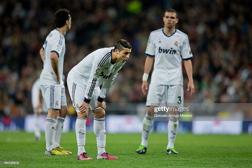 Cristiano Ronaldo (2ndL) of Real Madrid CF reacts exhausted with his team-mates Alvaro Arbeloa (L) and Pepe (R) during the La Liga match between Real Madrid CF and RCD Mallorca at Santiago Bernabeu Stadium on March 16, 2013 in Madrid, Spain.