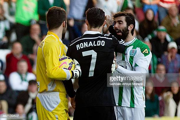 Cristiano Ronaldo of Real Madrid CF reacts next to Jose Angel Crespo of Cordoba CF beside his teammate goalkeeper Juan Carlos Martin shortly before...