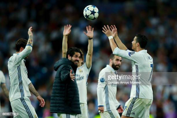 Cristiano Ronaldo of Real Madrid CF receives the ball for his hat trick after the UEFA Champions League Quarter Final second leg match between Real...