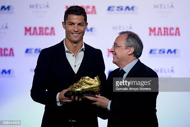 Cristiano Ronaldo of Real Madrid CF receives the Golden Boot award from president of Real Madrid CF Florentino Perez at Melia Castilla hotel on...