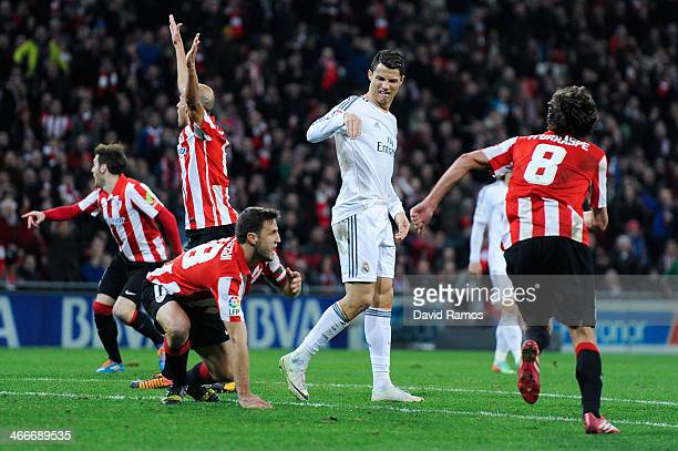 Cristiano Ronaldo of Real Madrid CF reproaches Carlos Gurpegi of Athletic Club after they clashed during the La Liga match between Athletic Club and...