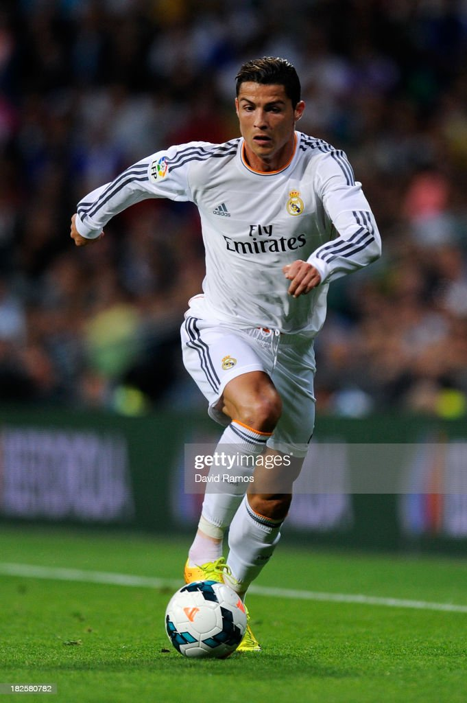 Cristiano Ronaldo of Real Madrid CF runs with the ball during the La Liga match between Real Madrid CF and Club Atletico de Madrid at Bernabeu on September 28, 2013 in Madrid, Spain.