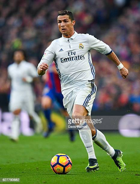 Cristiano Ronaldo of Real Madrid CF runs with the ball during the La Liga match between FC Barcelona and Real Madrid CF at Camp Nou stadium on...