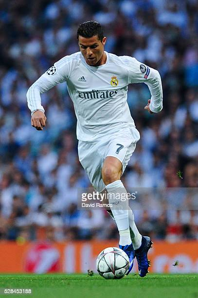 Cristiano Ronaldo of Real Madrid CF runs with the ball during the UEFA Champions League Semi Final second leg match between Real Madrid and...