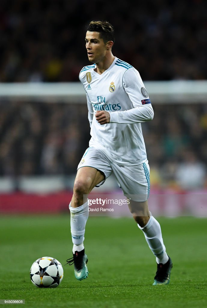 Cristiano Ronaldo of Real Madrid CF runs with the ball during the UEFA Champions League Quarter Final scond leg match between Real Madrid and Juventus at Estadio Santiago Bernabeu on April 11, 2018 in Madrid, Spain.