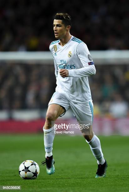 Cristiano Ronaldo of Real Madrid CF runs with the ball during the UEFA Champions League Quarter Final scond leg match between Real Madrid and...