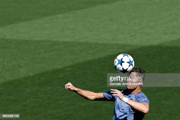 Cristiano Ronaldo of Real Madrid CF saves on a header during a training session ahead of the UEFA Champions League Semifinal Second leg match between...