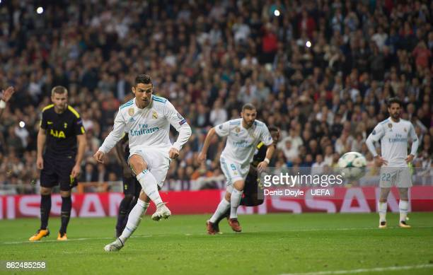 Cristiano Ronaldo of Real Madrid CF scores his team's opening goal from the penalty spot during the UEFA Champions League group H match between Real...