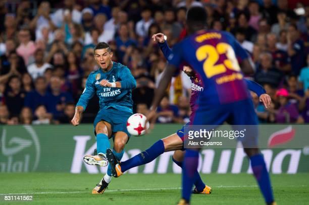 Cristiano Ronaldo of Real Madrid CF scores his team's second goal during the Supercopa de Espana Supercopa Final 1st Leg match between FC Barcelona...