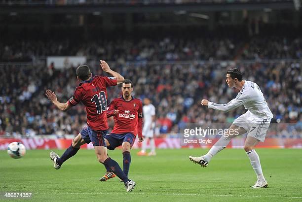 Cristiano Ronaldo of Real Madrid CF scores Real's second goal during the La Liga match between Real Madrid CF and CA Osasuna at the Santiago Bernabeu...