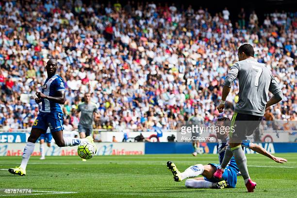Cristiano Ronaldo of Real Madrid CF scores the opening goal during the La Liga match between RCD Espanyol and Real Madrid CF at CornellaEl Prat...