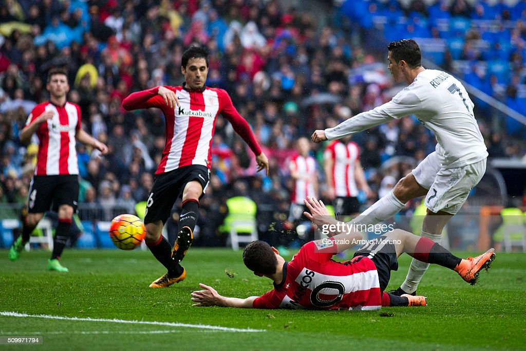 Cristiano Ronaldo (R) of Real Madrid CF scores their fourth goal during the La Liga match between Real Madrid CF and Athletic Club at Estadio Santiago Bernabeu on February 13, 2016 in Madrid, Spain.