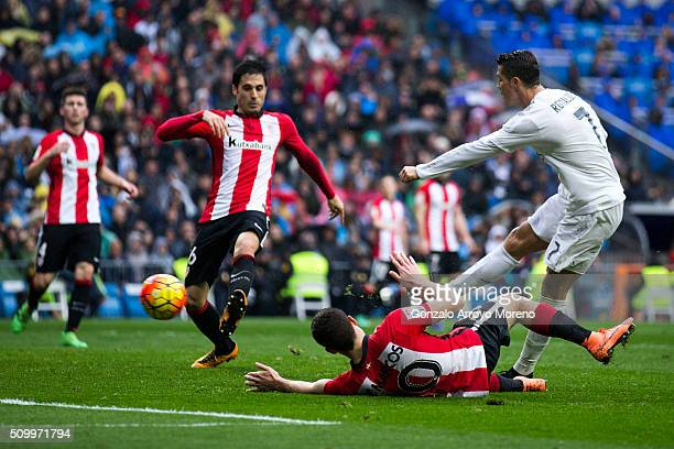 Cristiano Ronaldo of Real Madrid CF scores their fourth goal during the La Liga match between Real Madrid CF and Athletic Club at Estadio Santiago...
