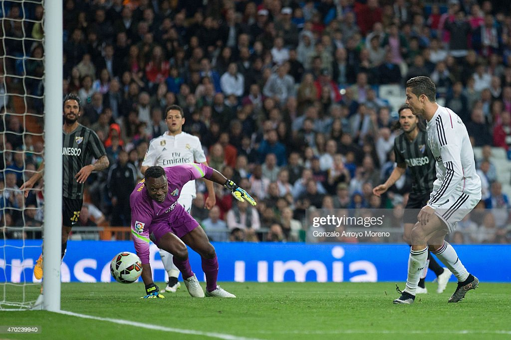 Cristiano Ronaldo of Real Madrid CF scores their third goal during the La Liga match between Real Madrid CF and Malaga CF at Estadio Santiago Bernabeu on April 18, 2015 in Madrid, Spain.