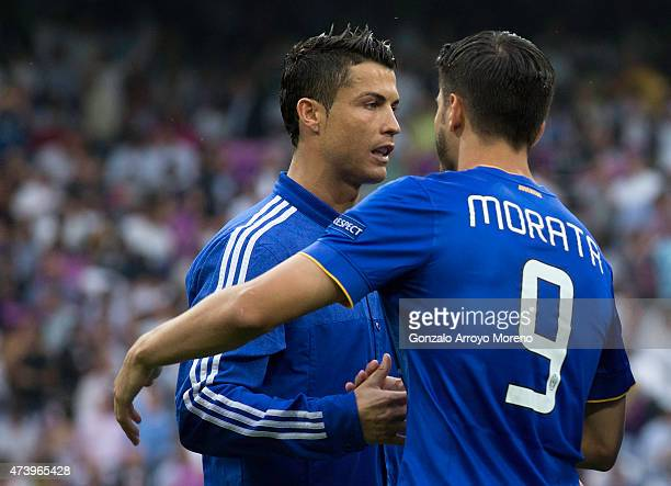 Cristiano Ronaldo of Real Madrid CF shakes hands with Alvaro Morata of Juventus prior to start the UEFA Champions League semifinal second leg match...
