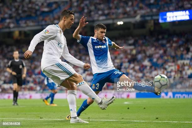 Cristiano Ronaldo of Real Madrid CF shoots past Aaron Martin of RCD Espanyolduring the La Liga match between Real Madrid and Espanyol at Estadio...