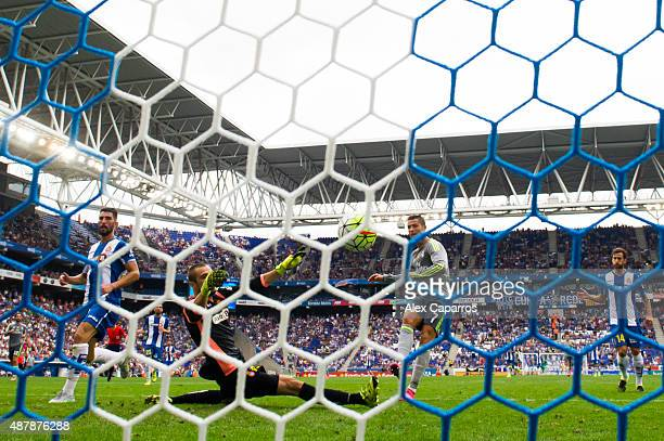 Cristiano Ronaldo of Real Madrid CF shoots the ball towards goal past goalkeeper Pau Lopez and scores his team's fifth goal during the La Liga match...