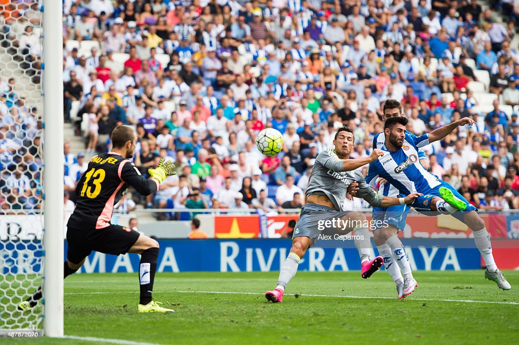 Cristiano Ronaldo of Real Madrid CF shoots towards goal with the opposition of Ruben Duarte of RCD Espanyol and scores his team's third goal during the La Liga match between RCD Espanyol and Real Madrid CF at Cornella-El Prat Stadium on September 12, 2015 in Barcelona, Spain.