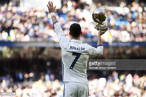 Cristiano Ronaldo of Real Madrid CF shows his fourth Golden Ball to the audience prior to start the La Liga match between Real Madrid CF and Granada...