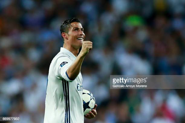 Cristiano Ronaldo of Real Madrid CF shows the ball as a gift for his hat trick after the UEFA Champions League Quarter Final second leg match between...