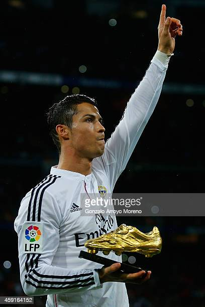Cristiano Ronaldo of Real Madrid CF shows to the audience his third Golden Boot award as best European scorer prior to start the La Liga match...