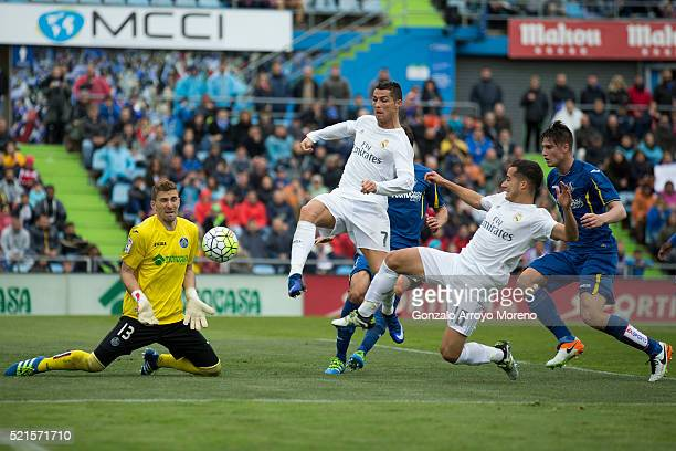 Cristiano Ronaldo of Real Madrid CF strikes the ball against goalkeeper Vicente Guaita of Getafe CF during the La Liga match between Getafe CF and...