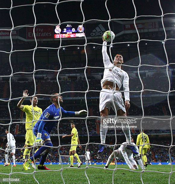 Cristiano Ronaldo of Real Madrid CF touches the ball with the hand after failing to score ahead goalkeeper Sergio Asenjo of Villarreal CF during the...