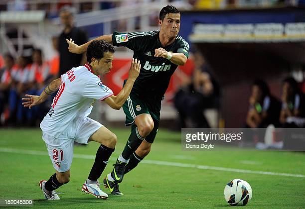Cristiano Ronaldo of Real Madrid CF tries to get past Cicinho of Sevilla FC during the La Liga match between Sevilla FC and Real Madrid at Estadio...