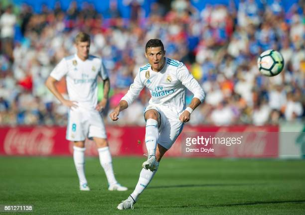 Cristiano Ronaldo of Real Madrid CF waits to restart the game after Getafe scored their 1st goal during the La Liga match between Getafe and Real...