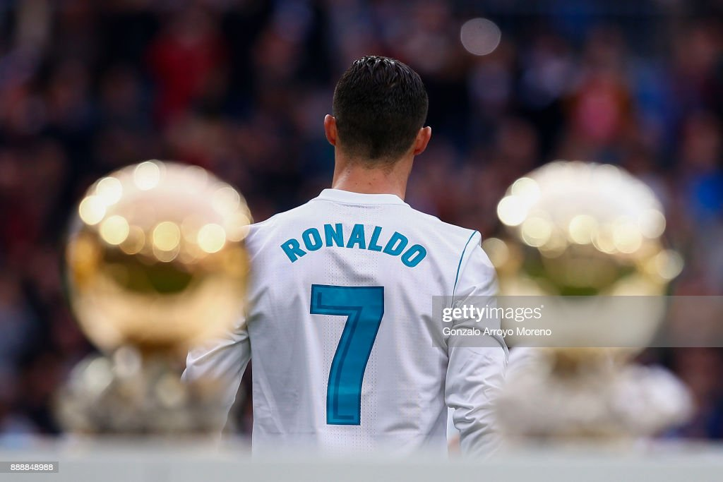 Cristiano Ronaldo of Real Madrid CF walks to the pitch after posing with his five Golden Ball (Ballon d'Or) trophies prior to start the La Liga match between Real Madrid CF and Sevilla FC at Estadio Santiago Bernabeu on December 9, 2017 in Madrid, Spain .