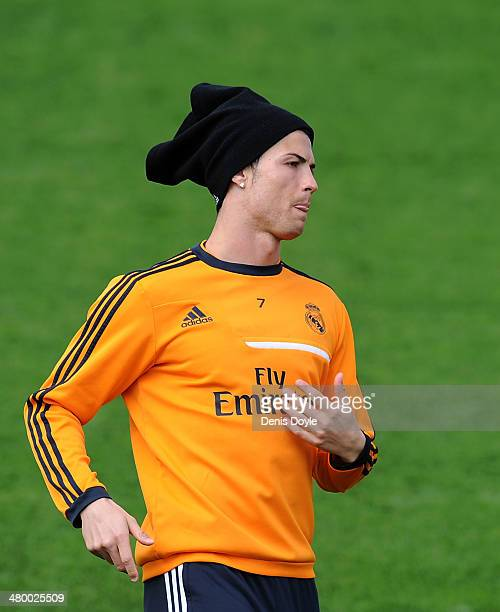 Cristiano Ronaldo of Real Madrid CF warms up during a team training session ahead of his El Clasico match against Barcelona at Valdebebas training...