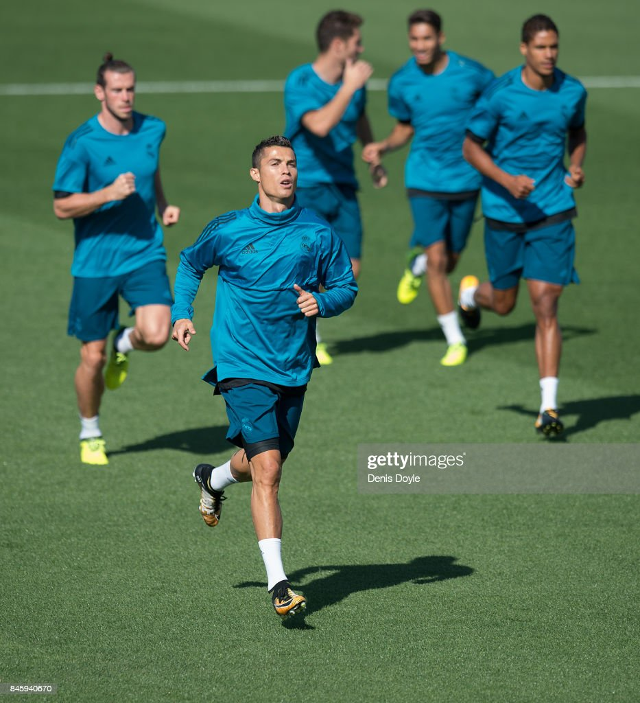 Cristiano Ronaldo of Real Madrid CF warms-up with teammates during the Real Madrid CF training session at Valdebebas training ground on September 12, 2017 in Madrid, Spain.