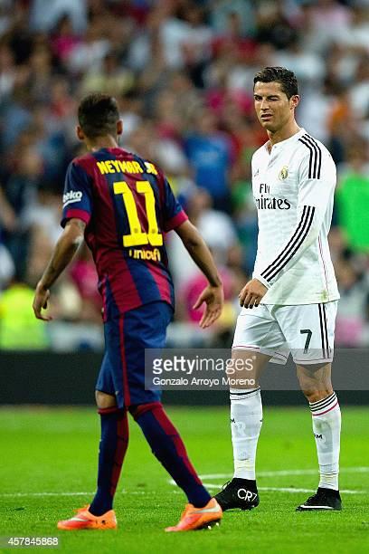 Cristiano Ronaldo of Real Madrid CF winks at Neymar of Barcelona during the La Liga match between Real Madrid CF and FC Barcelona at Estadio Santiago...