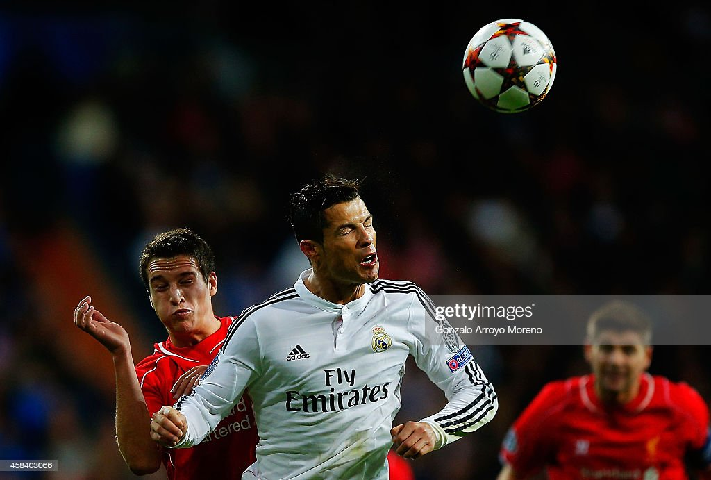 Cristiano Ronaldo of Real Madrid CF wins the header after Javier Manquillo of Liverpool FC during the UEFA Champions League Group B match between Real Madrid CF and Liverpool FC at Estadio Santiago Bernabeu on November 4, 2014 in Madrid, Spain.