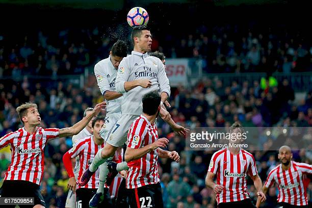 Cristiano Ronaldo of Real Madrid CF wins the header during the La Liga match between Real Madrid CF and Athletic Club de Bilbao at Estadio Santiago...