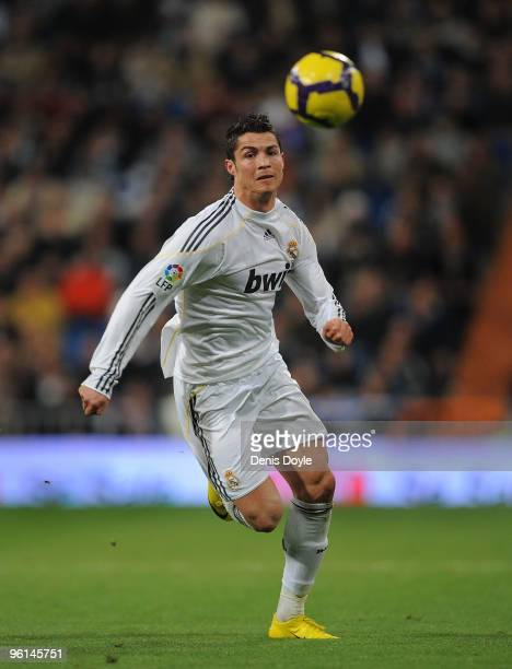 Cristiano Ronaldo of Real Madrid chases a long ball during the La Liga match between Real Madrid and Malaga at the Santiago Bernabeu stadium on...