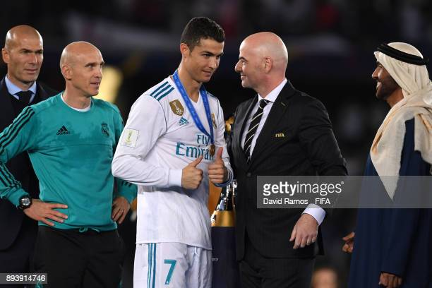 Cristiano Ronaldo of Real Madrid collects his adidas Golden Ball trophy from Gianni Infantino during the FIFA Club World Cup UAE 2017 Final between...