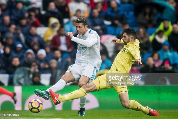 Cristiano Ronaldo of Real Madrid competes for the balding Alvaro Gonzalez Soberon of Villarreal CF during the La Liga 201718 match between Real...