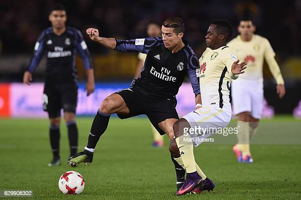 Cristiano Ronaldo of Real Madrid competes for the ball against Alex Ibarra of Club America during the FIFA Club World Cup Japan semifinal match...