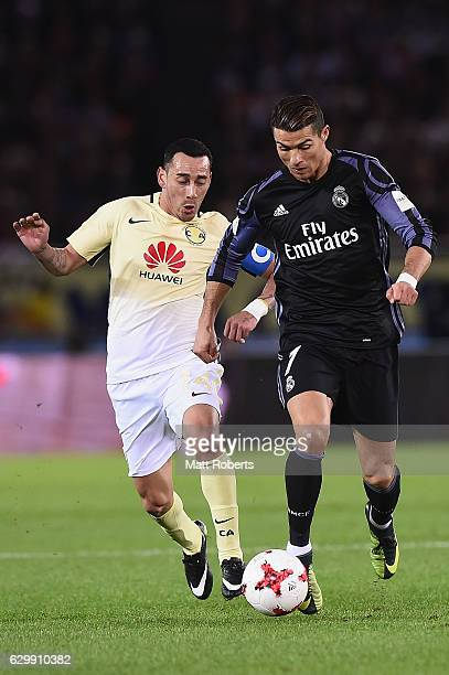 Cristiano Ronaldo of Real Madrid competes for the ball against Rubens Sambueza of Club America during the FIFA Club World Cup Japan semi-final match...
