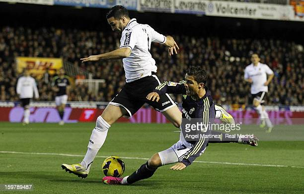 Cristiano Ronaldo of Real Madrid competes for the ball with Adil Rami of Valencia during the La Liga match between Valencia CF and Real Madrid at...