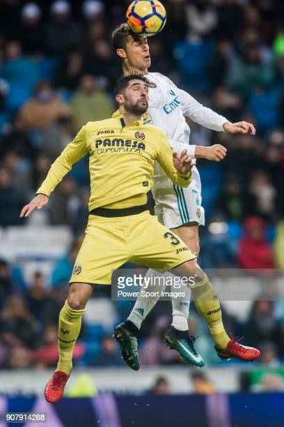 Cristiano Ronaldo of Real Madrid competes for the ball with Alvaro Gonzalez Soberon of Villarreal CF during the La Liga 201718 match between Real...