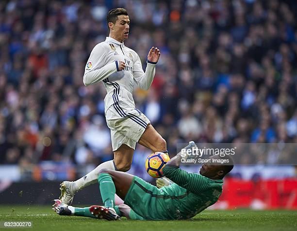Cristiano Ronaldo of Real Madrid competes for the ball with Carlos Kameni of Malaga during the La Liga match between Real Madrid CF and Malaga CF at...