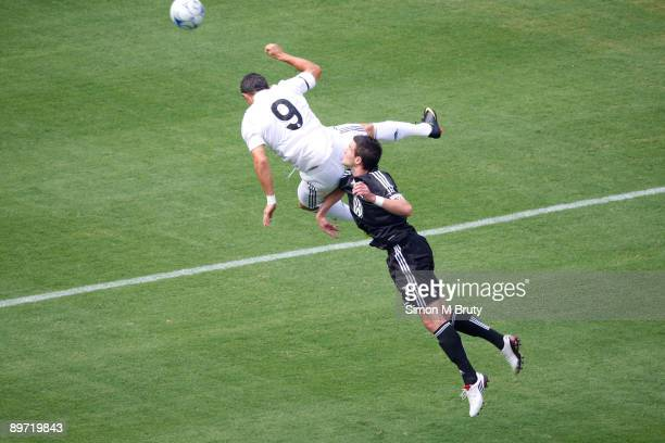 Cristiano Ronaldo of Real Madrid competes for the ball with Chris Pontius of DC United during the friendly match between Real Madrid and DC United at...