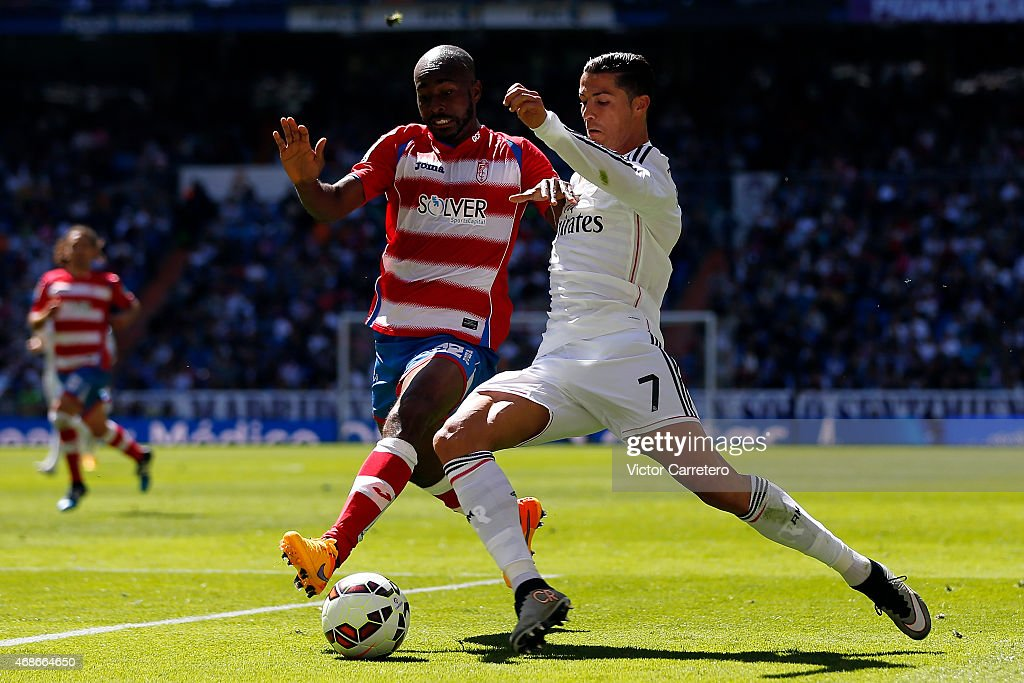 Cristiano Ronaldo (R) of Real Madrid competes for the ball with Dimitri Foulquier of Granada during the La Liga match between Real Madrid CF and Granda CF at Estadio Santiago Bernabeu on April 5, 2015 in Madrid, Spain.