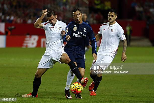 Cristiano Ronaldo of Real Madrid competes for the ball with Grzegorz Krychowiak of Sevilla FC during the La Liga match between Sevilla FC and Real...