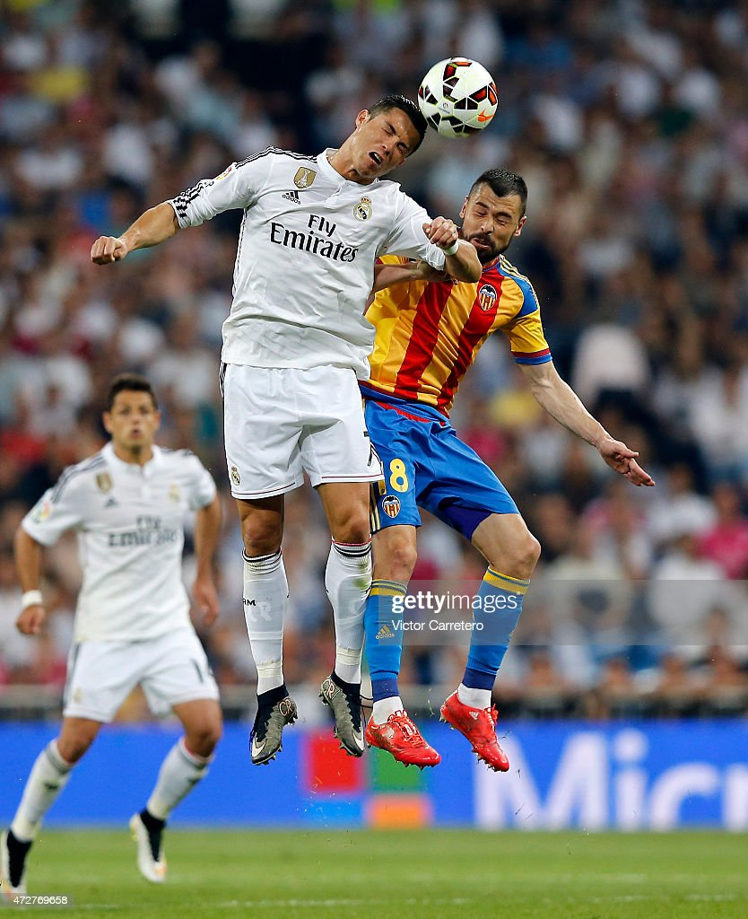Cristiano Ronaldo (L) of Real Madrid competes for the ball with Javi Fuego of Valencia during the La Liga match between Real Madrid CF and Valencia CF at Estadio Santiago Bernabeu on May 9, 2015 in Madrid, Spain.